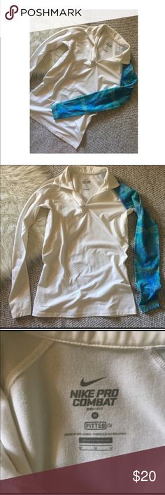 Nike Pro Combat Half Zip Nike pro combat half zip. Nike 'swoosh' under collar. One arm has a blue patter one it. Rest of the jacket is white. Freeze lined. Worn once. Perfect condition. Size Medium. Nike Jackets & Coats