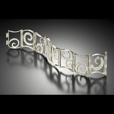 Small hinged  swirl bracelet- sterling silver- reversible (one side is oxidized, other is bright silver) by Lori Gottlieb
