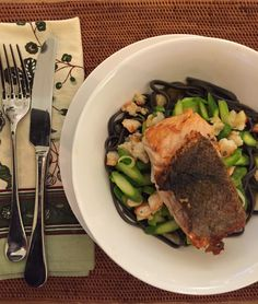 King Salmon Season is here... Grilled Salmon over Asparagus, Shrimp & Squid Ink Pasta.
