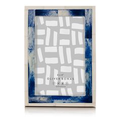 An unusual and interesting, photo frame made with cream and navy, bone tiles, giving an earthy, natural feel