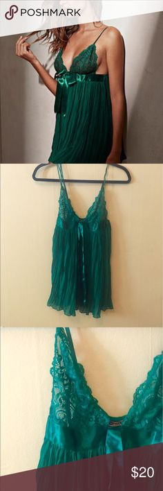 NWOT Green Victoria's Secret babydoll A beautiful deep green babydoll from Victoria's Secret. Size small, never worn- new without tags. See-through lace in the bust area with a pleated, flowy body. There's a ribbon that ties below the bust and can hang in the front. Adjustable spaghetti straps. Victoria's Secret Intimates & Sleepwear