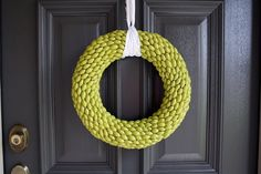 Painted acorn wreath.  Would be really cute with lima beans, too.