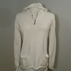 Tommy Hilfiger Hoodie White cotton knit zip neck hoodie by Tommy Hilfiger has cute hip pockets that have a curl out trim.  Runs larger, I have no trouble fitting it and am usually a medium.  Great for a beach getaway as it is versatile and can be worn over shorts, skirt, dress, bathing suit or jeans! Tommy Hilfiger Tops Sweatshirts & Hoodies