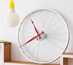 A stylish and super cool bike wheel clock. A unique decoration at home, on the walls of an executive office or in a university halls;