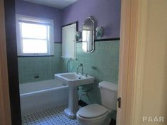 Very Unique Brick home with great features. Wood burning fireplace in the living room. 9x14 Enclosed Sun porch has bookshelves. Newer front and back doors and garage doors. 2 sets of glass french doors in the living room. Stove, refrigerator, dishwasher, washer & dryer stay + 5 window A/C units (2 are new). Rooms freshly painted. Hot water heat. Carpet on staircase is new. Some new plumbing. 3 Bedrooms upstairs & bathroom. Master Bedroom has 2 closets and 2 balcony windows. Upst...
