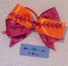 A personal favorite from my Etsy shop https://www.etsy.com/listing/398757011/pink-and-orange-glitter-softball-bow