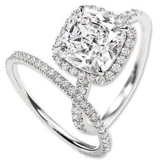 Harry Winston Cushion Cut Diamond Engagement Ring and Band harrywinston.com