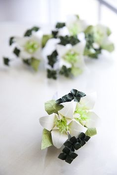 Origami Wedding Boutonnieres, also good example of different kinds of flowers we could use for bouquets or centerpieces.