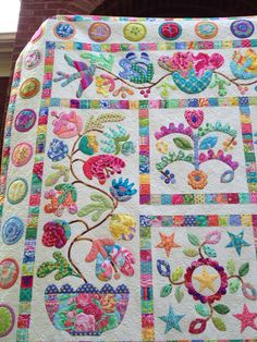Well here it is my finished Flower Pots quilt by Kim McLean.  This top was finished about 4 years ago and was my first, and almost only, us...