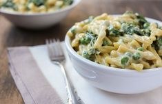 cheesy vegan alfredo with peas and kale - Luminous Vegans