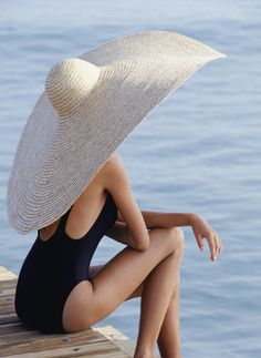giant hat and black swimsuit