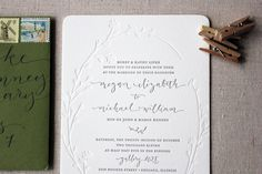 A gorgeous wedding invitation suite from Megan of Ruby the Fox.  You may remember Megan's awesome stitched save the dates from last April, and I'm just as much in love with her wedding invitations.  Megan wanted to keep the design simple and understated, with modern details in the blind impression letterpress elements, gorgeous calligraphy from Angelique Ink, and a custom garland illustration by the talented Shanna Murray.  So beautiful!