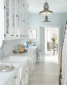 mint blue and white kitchen, industrial metal pendant lights, sherwin williams icelandic, sky blue, mint blue, seafoam green, pale blue, baby blue, light blue-green, green-blue, aqua blue