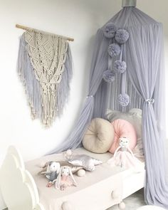 Light Grey Canopy, Pom Garland and Macrame Wall Hanging plus toys, pillows and blankie from www.missnmaster.com