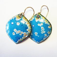 "Whether you're going to the office or out on the town, you'll feel special wearing these enamel blue earrings on gold-filled french wires. The leaf shape is enameled in blue, white and teal blue. Little cells of gold are revealed under opaque white and blue colors. Zoom in to see the fabulous texture! - 14k gold-filled french ear wires. If you prefer kidney wires as shown in image 5, please let me know and I'll be happy to switch. - 1.25"" total length x 7/8"" wide - 2 shades of blue (and… Blue Earrings, Leaf Earrings, Beaded Earrings, Enamel Jewelry, Jewelry Art, Teal Blue, Blue Colors, Porcelain Jewelry, Leaf Shapes"