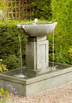 The shapely Brielle Cast-stone Fountain has a broad, deep base that will quickly become a garden or patio focal point.