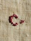 A linen handkechief believed to have belonged to King Charles I, English circa 1630-40, of plain white linen, embroidered in red silk cross-stitch with a C, 69 by 68cm. Provenance: Family tradition states this piece was left at Chisenbury by King Charles I.