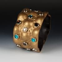 how to make leather jewlery with rivets grommets