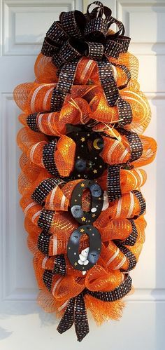Orange Halloween Mesh Wreath Halloween Boo Door/Wall Swag Mesh Wreath #halloween #mesh #wreath www.loveitsomuch.com