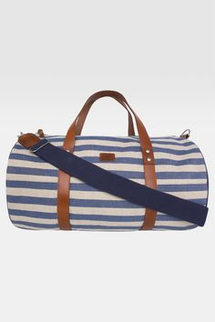 Practical and effortlessly stylish, this handsome nautical style duffle bag is a real highlight of our spring / summer accessories collection.