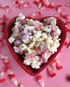 Cupid Crunch  (Printable Recipe)  Add this recipe to ZipList!  1 (24 oz) package vanilla Almond Bark   2 bags of lightly salted microwave popcorn, popped (approximately 16-20 cups popped popcorn)  1 1/2 cups Valentine candy corn  1 cup dry roasted, salted peanuts  1 1/2 cups M&Ms; (Valentine colors)    Pop popcorn and place in a large bowl. The largest you have.  Pour peanuts, candy corn, and M&Ms; on top.    Break up almond bark. Melt according to package directions. Pour over popcorn mixture. Stir until everything is well coated and then spread out onto waxed paper, parchment, or foil. Let sit until completely dry and then break up into clumps.