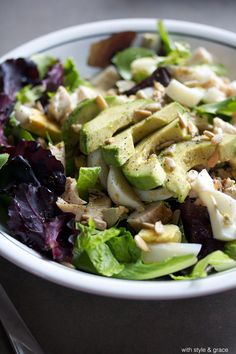 Power Protein Salad: 1  1 1/2 cups fresh spring mix 1/2 cup grilled chicken breasts, chopped 1 hard boiled egg, chopped 1/3-1/2 cup avocado, diced 1 tablespoon sunflower seeds Dressing: 2 tablespoons extra virgin olive oil 1 tablespoon soy sauce salt   pepper