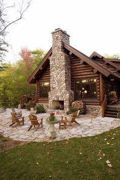Log cabin with outdoor fireplace