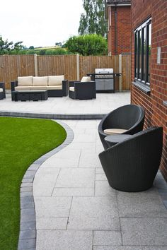 Stunning modern patio | Birch Granite Paving | Contemporary Garden | Wicker Furniture | Landscaping | Garden Seating | Installation completed by A. Ward Landscapes #wicker_garden_furniture