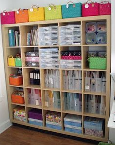 I like how she used an Expedit for her scrapbooking supplies. The colorful baskets on top are a cute touch, too.