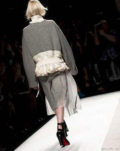 Sacai F/W 2014, grey sweater, ruffle, grey felt skirt, sheer, black pumps / Garance Doré