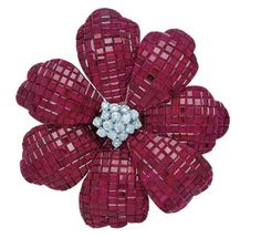 VCA inspired. Ruby Invisible set flower with diamond center.