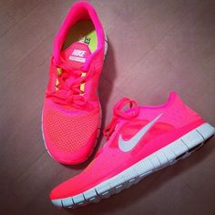 Bright pink nikes with yellow on the inside