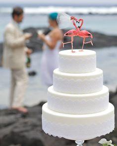 Tropical Destination Flamingo Wedding Cake Topper: Bride & Groom Love Birds - Flamingo Cake Topper in Pink. $30.00, via Etsy.