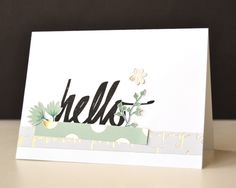 Here I first stamped the 'hello' on the white card base, then adhered two strips of pattern paper and some trimmed floral images.