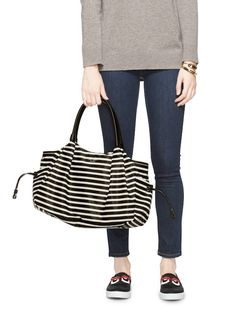 The classic Stevie bag from Kate Spade is a chic and roomy black-and-white diaper bag for spring.