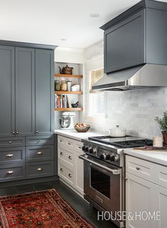 This two-toned kitchen with a rug and open shelving was H&H's fifth most popular pin of the year. | Photographer: Donna Griffith | Designer: Sarah Keenleyside & Lindsay Konior