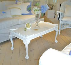 Shabby chic coffee table (etsy - $145) I would so get this and paint it black.