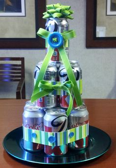 Diet Coke Cake Made with one 12 pack your choice of soda/beer etc. (7 on bottom 4 on second tier and one on top) Plate or platter on bottom and choice of embellishment. This is a cheap unique gift, great for coworkers male or female.