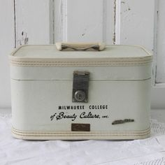 """Vintage suitcase from Milwaulkee College. Says """"A Beauty Culture."""""""