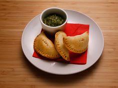 Pork and Potato Empanadas with Charred Tomatillo Sauce recipe from Anne Burrell via Food Network