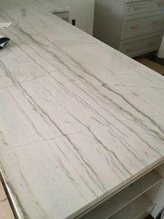 Backsplash Ideas For White Macaubus Quartzite In An Off White Kitchen