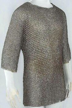 European riveted mail hauberk, Augsburg, Germany, late 14th century or early 15th century. Low-carbon steel and copper alloy. Length: 73.7 cm. Diameter: 1.11 cm, rings. Weight: 4.479 kg. The Wallace collection. (Wallace A1), Q1.