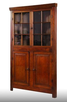 Ohio Walnut Corner Cabinet: Pinned and mortised construction, six paned glass doors, bottom doors with raised panels, circa 1840 Colonial Furniture, Primitive Furniture, Antique Furniture, Traditional Furniture, Painted Furniture, Modern Furniture, Furniture Design, Corner Cupboard, Corner Cabinets