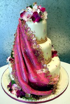Vibrant Pink Sari Design on an Indian inspired tiered Wedding Cake with gold accents and flowers..love!!