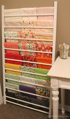 Crib side repurposed into fabric storage
