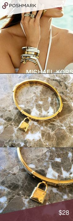 Michael Kors Lock Pave Bracelet Authentic MK Lock and Pave Gold Bracelet. Gently worn. No tarnish. Shows minuscule signs of wear. No box. ABSOLUTELY NO OFFERS 🚫MY LOWEST PRICE IS LISTED 🚫BUY IT NOW OPTION ONLY 🚫I ONLY TRADE FOR CASH 💰 Michael Kors Jewelry Bracelets