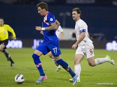 Mario Mandzukic (L) of Croatia fights for the ball with Branislav Ivanovic of Serbia during 2014 FIFA World Cup qualification soccer match at the Maksimir stadium in Zagreb, capital of Croatia, March 22, 2013. Croatia won 2-0.