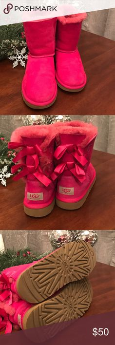 Pink Uggs kids size 4, fits woman's 6 Good condition pink Uggs. There are a couple of small scuff marks and there are some little cuts in the fabric on the left shoe (please see photo). Otherwise very good condition. Super cute UGG Shoes Ankle Boots & Booties