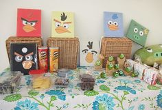 The large square angry birds are paper covered cardboard with Printable angry bird faces.