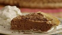 Chocolate Chess Pie 1/4 cup butter, softened      2 eggs      3 tablespoons unsweetened cocoa powder      1 1/2 cups white sugar      2/3 cup evaporated milk   ...